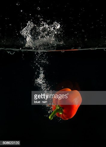 Pepper in water : Stock Photo