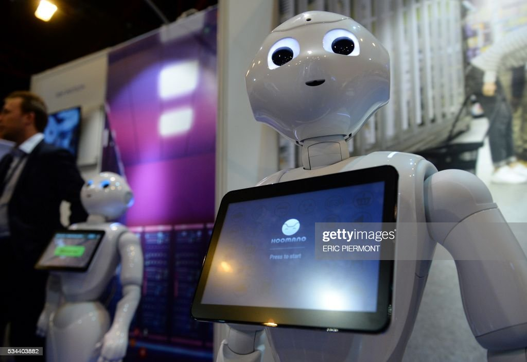 Pepper Robots of Softbank are on display at the Robotics event Innorobo in La Plaine Saint-Denis on May 26, 2016. / AFP / ERIC