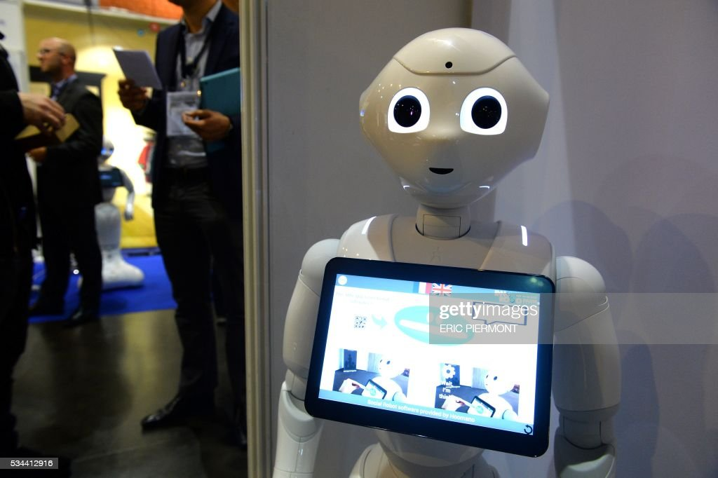 Pepper Robots of Softbank is on display at the Robotics event Innorobo in La Plaine Saint-Denis on May 26, 2016. / AFP / ERIC