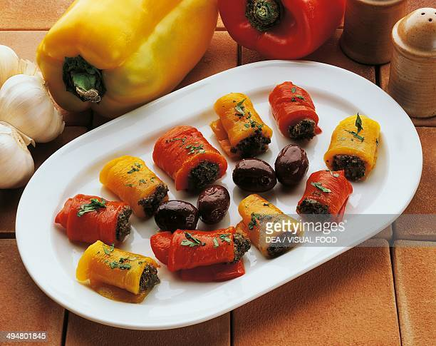 Pepper rolls filled with olive sauce and tomatoes