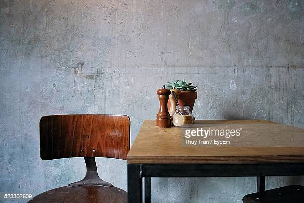 Pepper Shaker And A Jar Of Honey On A Table