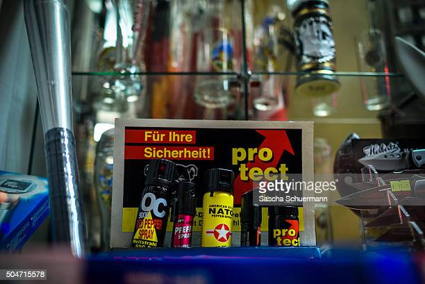Pepper spray is shown on display near the Hauptbahnhof main railway station at a store window where on New Year's Eve gangs of what victims described...