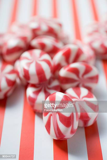 Peppermint candies on striped background, close up