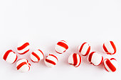 Peppermint candies on white background from above. Copyspace. Christmas mood concept.