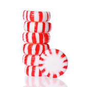 Peppermint candy tower isolated on white. Red striped peppermint Christmas candy, macro.