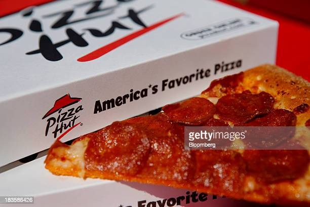 A pepperoni pizza from a Pizza Hut restaurant a unit of Yum Brands Inc is arranged for a photograph in Torrance California US on Monday Oct 7 2013...