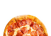 Top view of a half pepperoni pizza on white background with copy space.