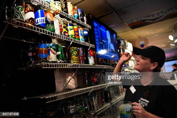 Pepperoni's Supervisor Dani Dresch searching for a mug at Pepperoni's a watering hole in the lodge basement at the base of Mary Jane ski area that...