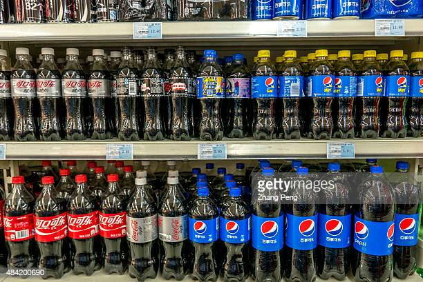 Pepsi and CocaCola products in a Chinese supermarket Coke companies are suffering large decline in consumption of sugary sodas as consumers worry...