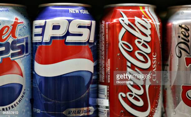 Pepsi and CocaCola products sit on display in a New York supermarket Monday December 12 2005 CocaCola Co and PepsiCo Inc are headed for their first...