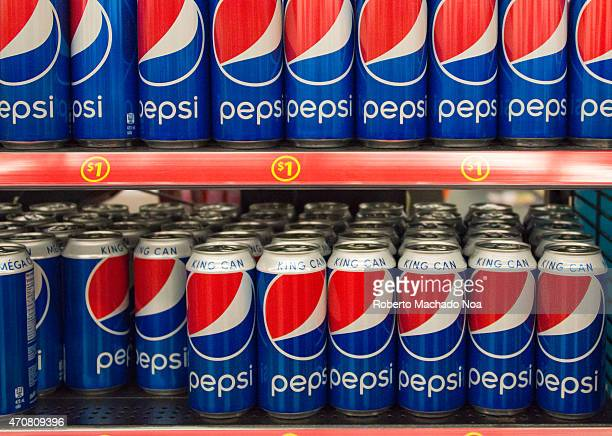 Pepsi Cola King Can on Store Shelf Pepsi is a carbonated soft drink that is produced and manufactured by PepsiCo and distributed all over the world