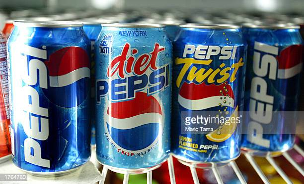 Pepsi soft drink cans are seen February 6 2003 in New York City PepsiCo Inc announced February 6 that fourthquarter profits rose with fourthquarter...