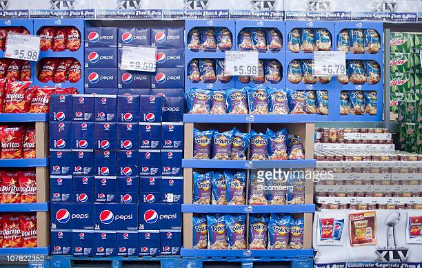 PepsiCo Inc Pepsi Tostitos and Doritos products sit on display inside a BJ's Wholesale Club store in Falls Church Virginia US on Thursday Dec 30 2010...