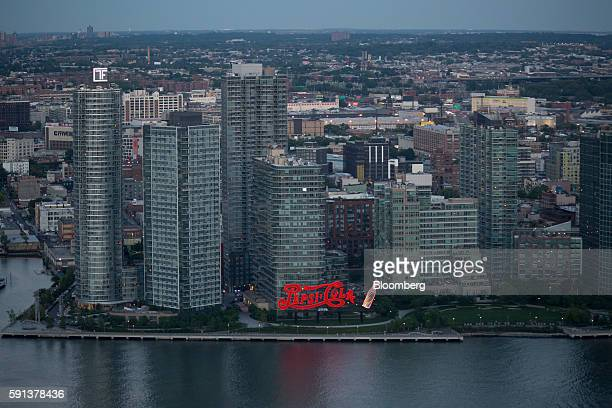 PepsiCo Inc signage is seen standing along the East River from the 50 United Nations Plaza building in New York US on Tuesday June 7 2016 About 3574...