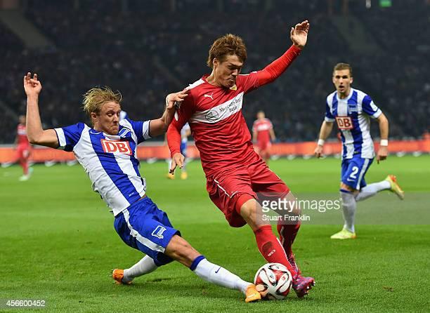 Per Ciljan Skjebred of Berlin is challenged by Gotoku Sakai of Stuttgart during the Bundesliga match between Hertha BSC and Vfb Stuttgart at...