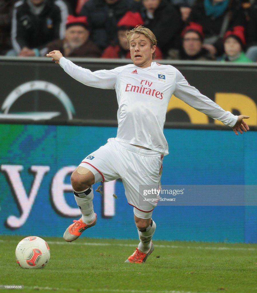Per Ciljan Skjelbred of Hamburg runs with the ball during the Bundesliga match between Bayer Leverkusen and Hamburger SV at BayArena on December 15, 2012 in Leverkusen, Germany.