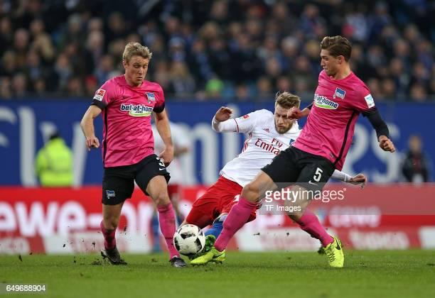 Per Ciljan Skjelbred of Hertha BSC Berlin and Aaron Hunt of Hamburg and Niklas Stark of Hertha BSC Berlin battle for the ball during the Bundesliga...
