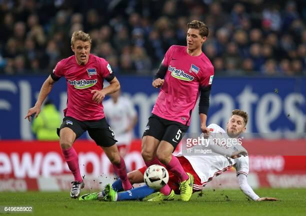 Per Ciljan Skjelbred of Hertha BSC Berlin and Niklas Stark of Hertha BSC Berlin and Aaron Hunt of Hamburg battle for the ball during the Bundesliga...