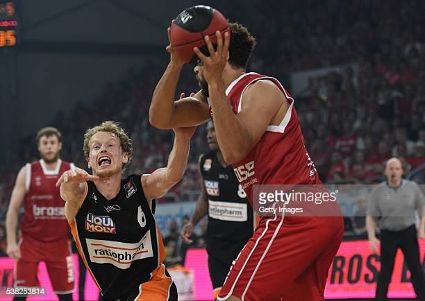 Per Günther battles for the ball with Elias Harris during the BEKO BBL Final game 1 between Brose Baskets Bamberg and ratipopharm Ulm at Brose Arena...