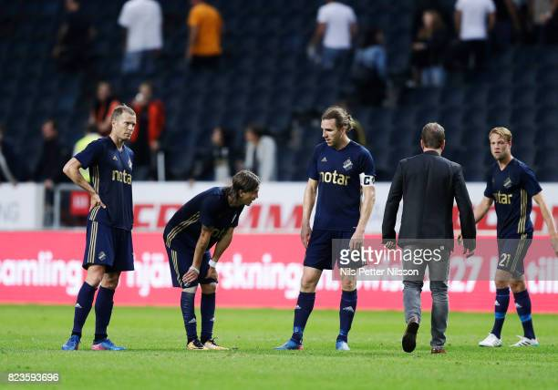 Per Karlsson Kristoffer Olsson and NilsEric Johansson of AIK dejected after the UEFA Europa League Qualifying match between AIK and SC Braga at...
