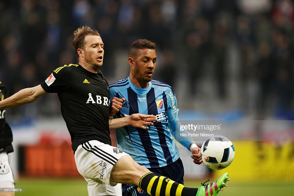 Per Karlsson of AIK and <a gi-track='captionPersonalityLinkClicked' href=/galleries/search?phrase=Mathias+Ranegie&family=editorial&specificpeople=8283787 ng-click='$event.stopPropagation()'>Mathias Ranegie</a> of Djurgardens IF competes for the ball during the Allsvenskan match between AIK and Djurgardens IF at Friends arena on May 16, 2016 in Solna, Sweden.