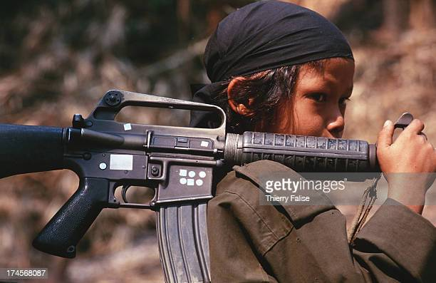 Per Ler a 12 yearold soldier in Kamerplaw southern Burma headquarters of God's Army a ragtag breakaway guerrilla faction of the Christian Karen...