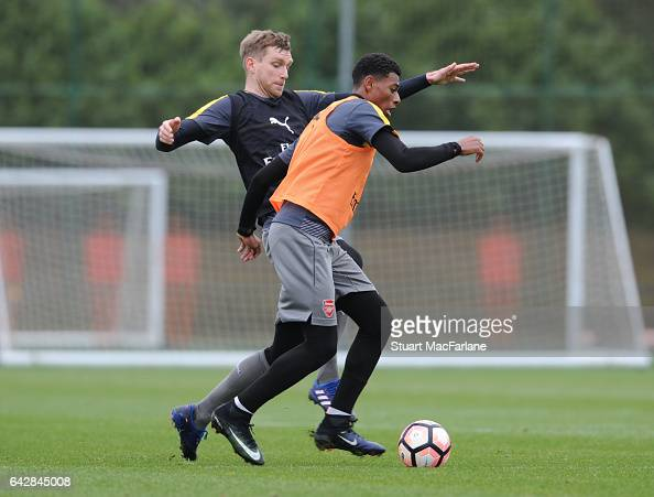 Per Merteacker and Jeff ReineAdelaide of Arsenal during a training session on February 19 2017 in St Albans England