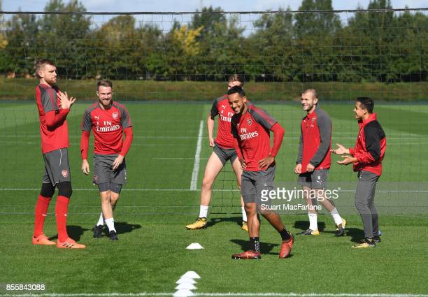 Per Mertesacker Aaron Ramsey Theo Walcott Jack Wilshere and Alexis Sanchez of Arsenal during a training session at London Colney on September 30 2017...