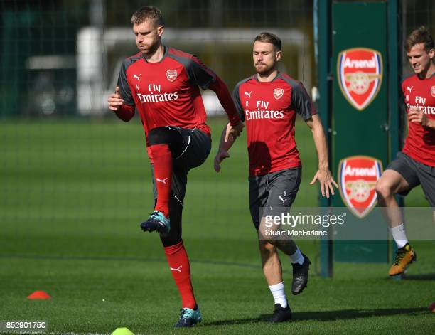 Per Mertesacker and Aaron Ramsey of Arsenal during a training session at London Colney on September 24 2017 in St Albans England