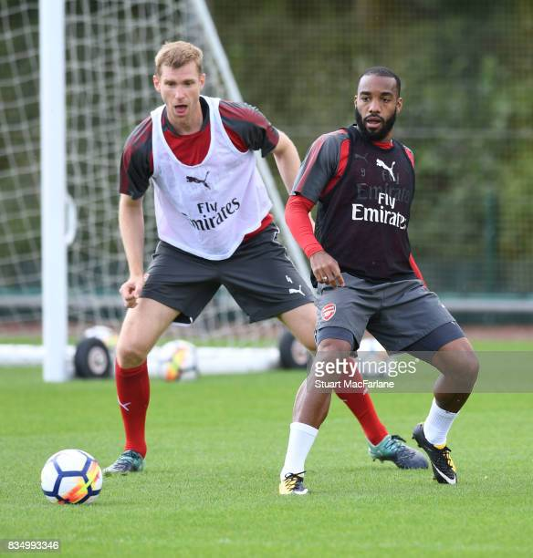 Per Mertesacker and Alex Lacazette of Arsenal during a training session at London Colney on August 18 2017 in St Albans England