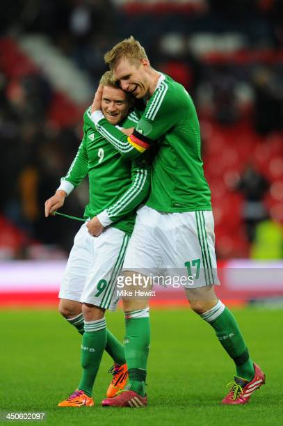 Per Mertesacker and Andre Schuerrle of Germany celebrates their team's 10 victory during the international friendly match between England and Germany...