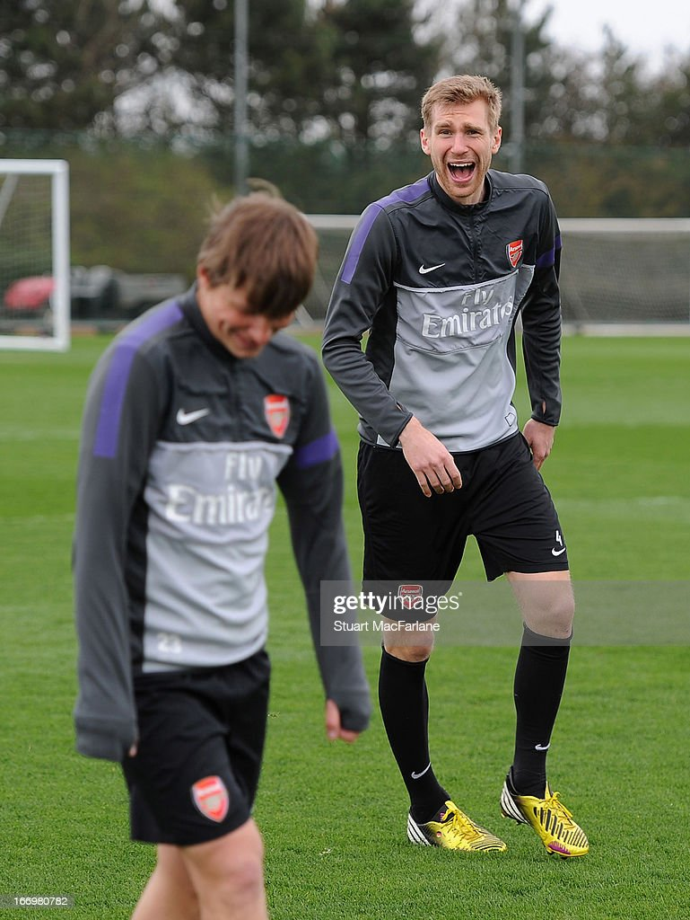 <a gi-track='captionPersonalityLinkClicked' href=/galleries/search?phrase=Per+Mertesacker&family=editorial&specificpeople=207135 ng-click='$event.stopPropagation()'>Per Mertesacker</a> and Andrey Arshavin of Arsenal during a training session at London Colney on April 19, 2013 in St Albans, England.