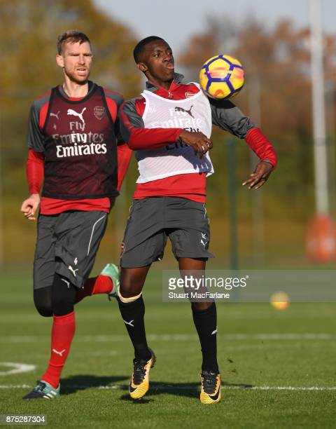 Per Mertesacker and Eddie Nketiah of Arsenal during a training session at London Colney on November 17 2017 in St Albans England
