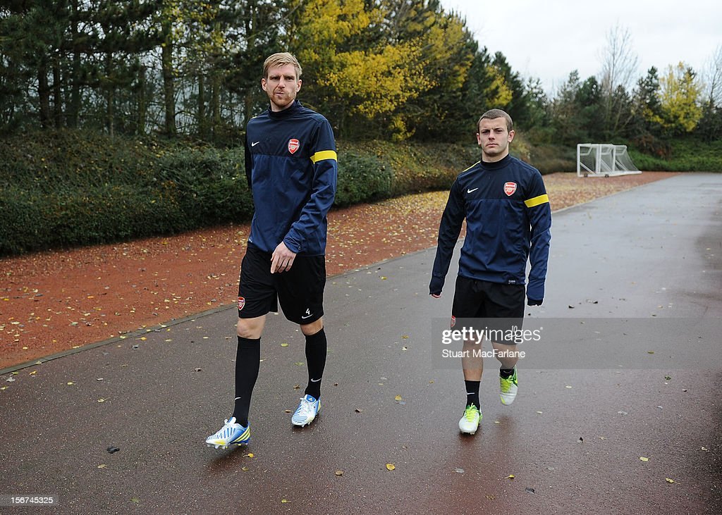 Per Mertesacker and Jack Wilshere of Arsenal before a training session at London Colney on November 20, 2012 in St Albans, England.