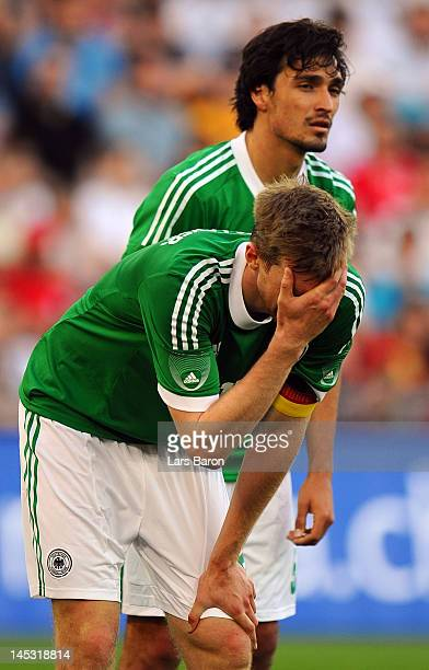 Per Mertesacker and Mats Hummels of Germany are looking dejected during the international friendly match between Switzerland and Germany at St...