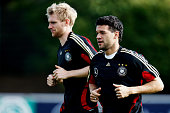 Per Mertesacker and Michael Ballack warm up during a training session of the German national football team at the Bruchweg stadium training ground on...