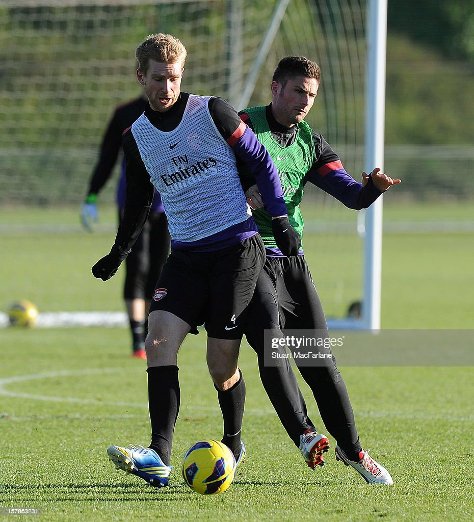 Per Mertesacker and Olivier Giroud of Arsenal during a training session at London Colney on December 07, 2012 in St Albans, England.