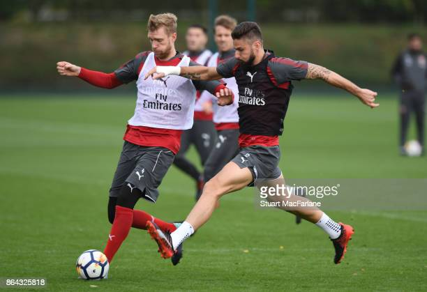Per Mertesacker and Olivier Giroud of Arsenal during a training session at London Colney on October 21 2017 in St Albans England