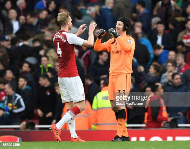 Per Mertesacker and Petr Cech of Arsenal after the Premier League match between Arsenal and Swansea City at Emirates Stadium on October 28 2017 in...