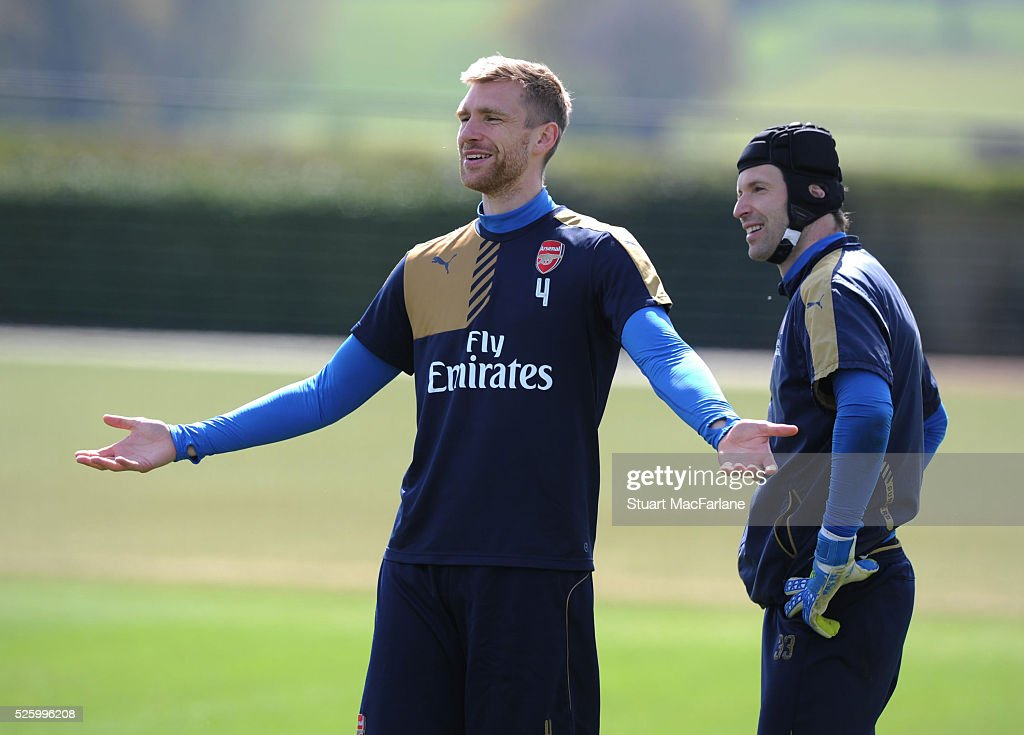 <a gi-track='captionPersonalityLinkClicked' href=/galleries/search?phrase=Per+Mertesacker&family=editorial&specificpeople=207135 ng-click='$event.stopPropagation()'>Per Mertesacker</a> and <a gi-track='captionPersonalityLinkClicked' href=/galleries/search?phrase=Petr+Cech&family=editorial&specificpeople=212890 ng-click='$event.stopPropagation()'>Petr Cech</a> of Arsenal react during a training session at London Colney on April 29, 2016 in St Albans, England.