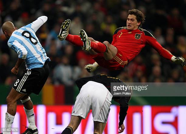 Per Mertesacker and Rene Adler of Germany and Juan Sebastian Veron of Argentina compete for the ball during the International Friendly match between...