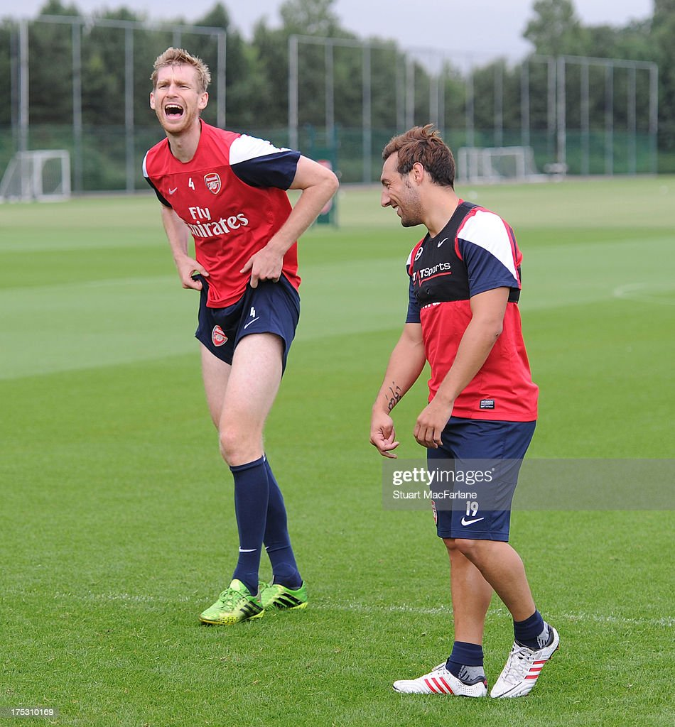 <a gi-track='captionPersonalityLinkClicked' href=/galleries/search?phrase=Per+Mertesacker&family=editorial&specificpeople=207135 ng-click='$event.stopPropagation()'>Per Mertesacker</a> and <a gi-track='captionPersonalityLinkClicked' href=/galleries/search?phrase=Santi+Cazorla&family=editorial&specificpeople=709830 ng-click='$event.stopPropagation()'>Santi Cazorla</a> of Arsenal joke around during a training session at London Colney on August 02, 2013 in St Albans, England.