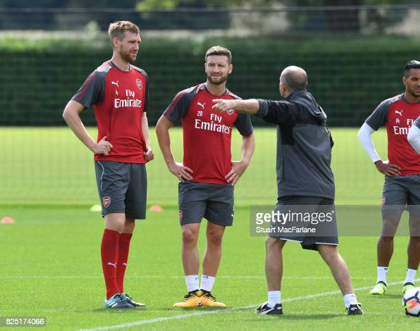 Per Mertesacker and Shkodran Mustafi with Arsenal 1st team coach Tony Colbert during a training session at London Colney on August 1 2017 in St...