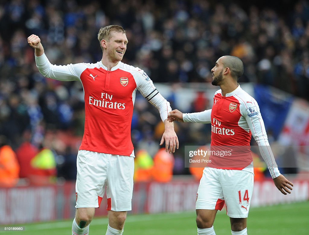<a gi-track='captionPersonalityLinkClicked' href=/galleries/search?phrase=Per+Mertesacker&family=editorial&specificpeople=207135 ng-click='$event.stopPropagation()'>Per Mertesacker</a> and <a gi-track='captionPersonalityLinkClicked' href=/galleries/search?phrase=Theo+Walcott&family=editorial&specificpeople=451535 ng-click='$event.stopPropagation()'>Theo Walcott</a> of Arsenal celebrates after the Barclays Premier League match between Arsenal and Leicester City at Emirates Stadium on February 14th, 2016 in London, England