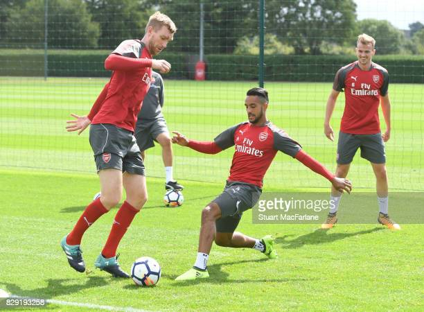 Per Mertesacker and Theo Walcott of Arsenal during a training session at London Colney on August 10 2017 in St Albans England