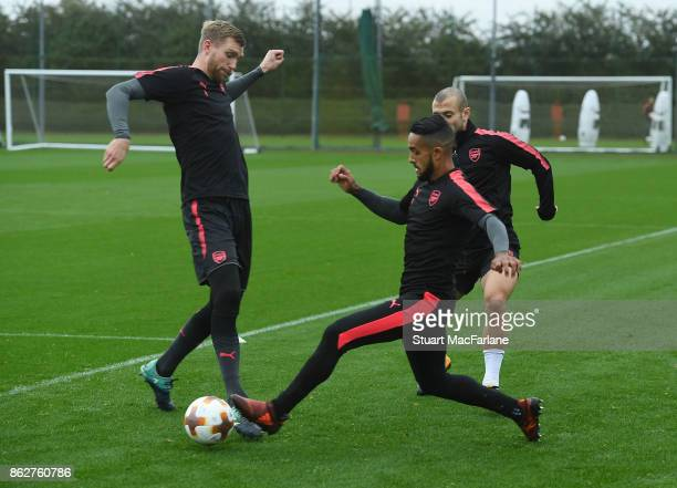 Per Mertesacker and Theo Walcott of Arsenal during a training session at London Colney on October 18 2017 in St Albans England