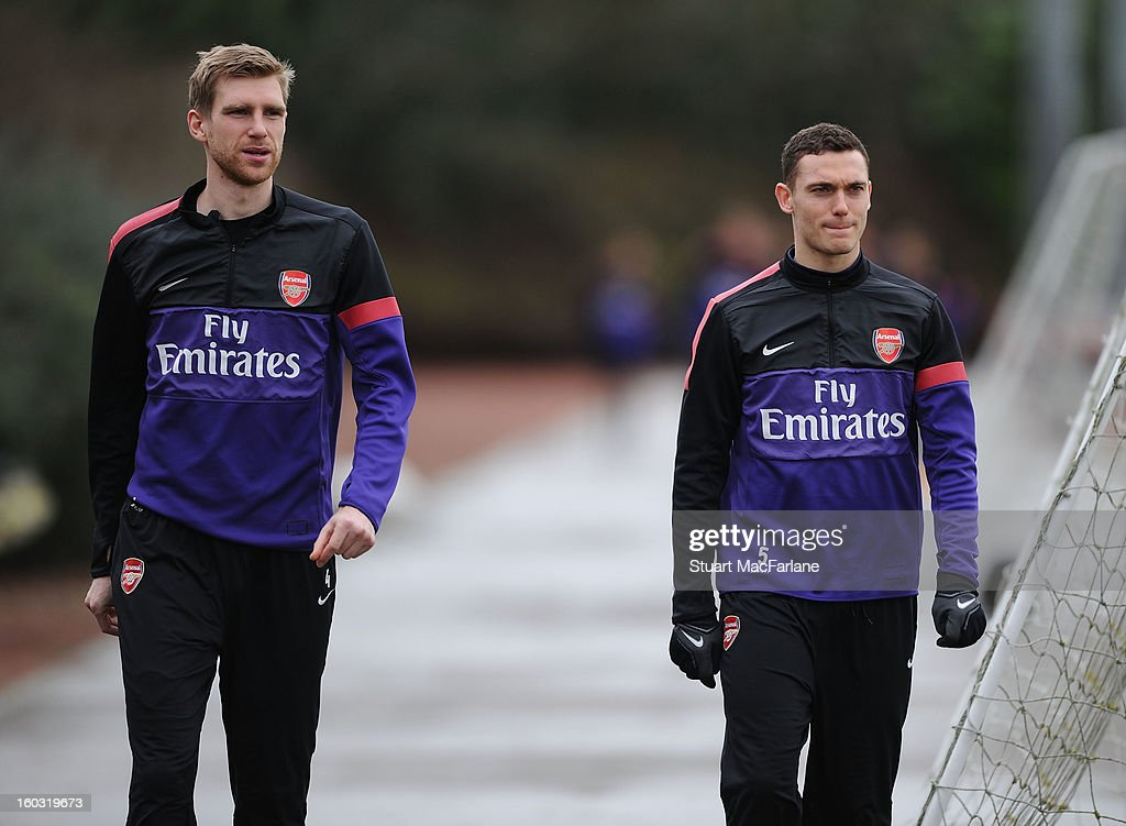 Per Mertesacker and Thomas Vermaelen of Arsenal before a training session at London Colney on January 29, 2013 in St Albans, England.