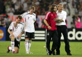 Per Mertesacker Bastian Schweinsteiger Torsten Frings of Germany and coach Jurgen Klinsmann look dejected following defeat during the FIFA World Cup...