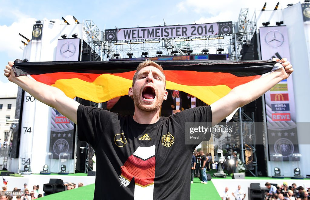 <a gi-track='captionPersonalityLinkClicked' href=/galleries/search?phrase=Per+Mertesacker&family=editorial&specificpeople=207135 ng-click='$event.stopPropagation()'>Per Mertesacker</a> celebrates during the German team victory ceremony on July 15, 2014 in Berlin, Germany. Germany won the 2014 FIFA World Cup Brazil match against Argentina in Rio de Janeiro on July 13.