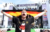 Per Mertesacker celebrates during the German team victory ceremony on July 15 2014 in Berlin Germany Germany won the 2014 FIFA World Cup Brazil match...